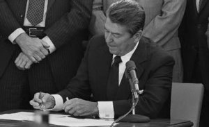 President Reagan (R) signs the Anti-Torture Treaty